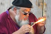MUSKOGEE, OK - MAY 24: Skillful merchant shows off his crafts at the Oklahoma 19th annual Renaissance Festival on May 24, 2014 at the Castle of Muskogee in Muskogee, OK
