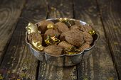 Bowl Of Walnuts For Christmas Time On Wooden Old Background.