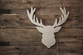 Deer Head With Antler For Christmas Decoration On Wooden Background.