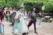 MUSKOGEE, OK - MAY 24: Actors dressed in historical outfits walk in the village parade during the Ok