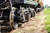 picture of train-wheel  - Closeup of the old rusty train wheels - JPG