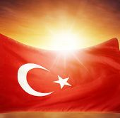 Turkish flag in front of bright sky