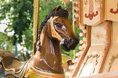 stock photo of carousel horse  - a brown horse of a carousel in a park - JPG