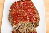 Fresh Baked Meatloaf On White Cutting Board