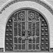 stock photo of nana  - Old wooden door black and white image door in an ancient monastery background with historical - JPG