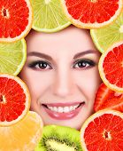 Woman beauty face with fruits frame, close-up