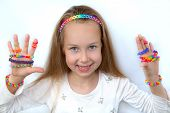 Loom bangs. Little girl demonstrated her craft work