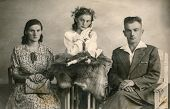 SIERADZ, POLAND, CIRCA FORTIES - Vintage photo of parents with their daughter at her First Communion