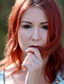 Redhead Girl Enjoying Summer Sunlight And Calm Wind