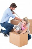 Young couple packing moving boxes on white background