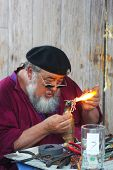 MUSKOGEE, OK - MAY 24: An old man uses fire to create a piece of art at the Oklahoma 19th annual Ren