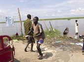 BOR, SOUTH SUDAN-JUNE 26 2012: Unidentified fisherman hauls catfish out of the Nile River in South S