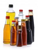 Different bottles of sauce and cooking oil