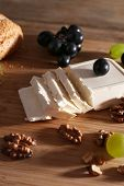 still life with tasty cheese, grape and bread, close up