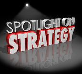 Spotlight on Strategy 3d words illustrating the importance of planning, vision and big ideas for suc