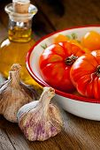 Tomatoes In A Bowl, Garlic And Olive Oil