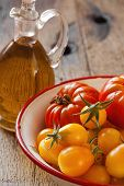 Tomatoes In A Bowl And Olive Oil