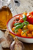 Tomatoes In A Bowl, Garlic, Basil And Olive Oil