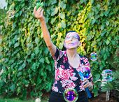 Grandma Playing With Soap Bubbles