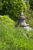 Asian Temple Like A Stupa In The Garden. Asiatic Background.