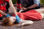 Paramedic Helping Unconscious Woman