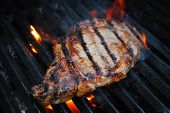 Flame Grilling A Lean Beef Steak On The Grill