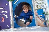 Happy Boy on Playground Equipment