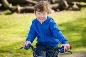 Toddler Boy Smiling on a Climbing Frame
