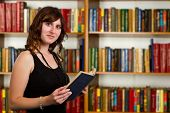 Portrait Of Clever Student With Open Book