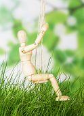 Man on swings