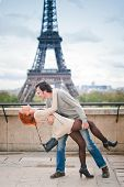 Loving Couple Kissing Near The Eiffel Tower In Paris