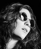 Closeup Portrait Of Beautiful Young Girl In Round Sunglasses. Black And White