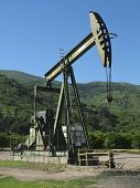 stock photo of oil well  - Oil pump near Ojai in Ventura County - JPG