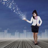 Full Length Of Woman Holds Digital Tablet