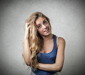blonde girl looking embarrassed
