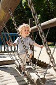 Boy Having Fun On The Playground