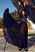 Beautiful Girl With Dark Hair In Luxurious Black Dress