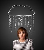 Thoughtful young woman with thundercloud above her head