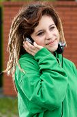 Smiling Girl With Dreadlocks Listening To Music