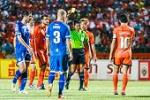 Sisaket Thailand-august 13: The Referee (green) Show A Yellow Card