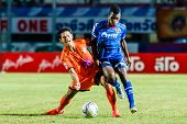 Sisaket Thailand-august 13: Alongkorn Pratoomwong Of Sisaket Fc. (orange) In Action During Thai Prem
