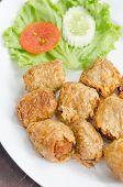 stock photo of crab-cakes  - deep fried crab meat roll cake on white dish chinese food