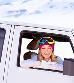Portrait of cute happy woman in the car going to the ski resort, active lifestyle, enjoying winter vacation concept
