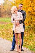 Young Couple Walking In The Park And Laughing