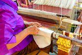 Old Woman Weaving Silk On Loom