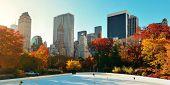Central Park Autumn ice rink midtown skyline in Manhattan New York City