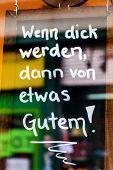 switzerland, zurich, sign slogan to get fat in a consumer society