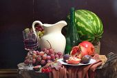 Still-life With Wine, Grapes, A Pomegranate, A Fig, A Water-melon And A White Jug