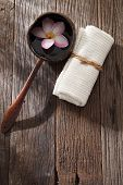 frangipani flower ,hand towel and coconut shell with handle
