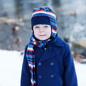 Adorable Toddler Boy On Beautiful Winter Day